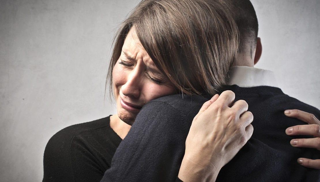 tearful hug